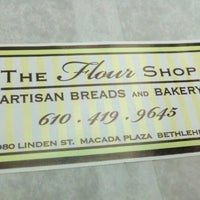 Photo taken at The Flour Shop Bakery by El R. on 10/4/2012
