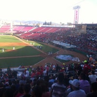 Photo taken at Estadio Gasmart by Rodrigo P. on 7/18/2013