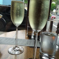 Photo taken at Celilo Restaurant & Bar by Diana G. on 4/23/2016