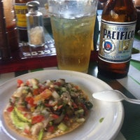 Photo taken at Mariscos Changuirongo by Liliana Isabel A. on 12/6/2014