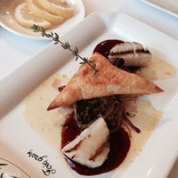 Photo taken at Bouchons Bistro by 林 Ceci on 7/20/2014