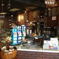Photo taken at 4 Corners Cafe by Nicki P. on 8/11/2013
