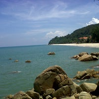 Photo taken at Pantai Teluk Cempedak (Beach) by Kinah A. on 4/18/2013