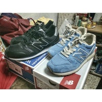 Photo taken at New Balance by Lee Z. on 7/31/2014