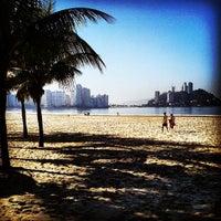 Photo taken at Praia do Gonzaguinha by Pedro Paulo D. on 5/10/2013