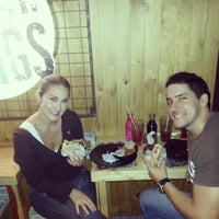 Photo taken at Burger & Wings by Daniela J. on 7/1/2014