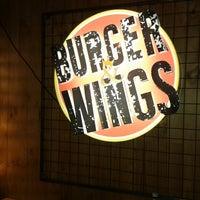 Photo taken at Burger & Wings by Daniela J. on 3/21/2014
