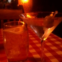 Photo taken at Buca's Tuscan Roadhouse by Joe R. on 8/9/2013
