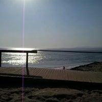 Photo taken at Praia do CDS by Nina S. on 6/25/2013