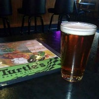 Photo taken at Turtle's Bar and Grill by Brian H. on 10/21/2013