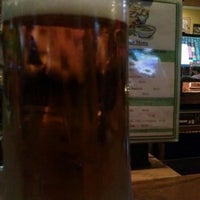 Photo taken at Turtle's Bar and Grill by Brian H. on 10/7/2014