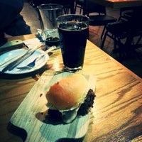 Photo taken at Grind Burger Kitchen by Graham B. on 2/1/2015