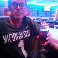 Photo taken at Mulligan's Beach House Bar & Grill by Dave H. on 9/13/2015
