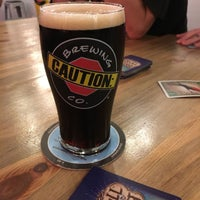 Photo taken at CAUTION: Brewing Company by Robbie S. on 9/15/2017