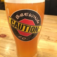 Photo taken at CAUTION: Brewing Company by Robbie S. on 9/22/2017