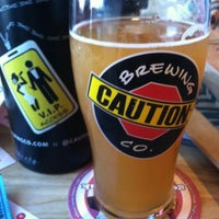 Photo taken at CAUTION: Brewing Company by Robbie S. on 1/18/2014