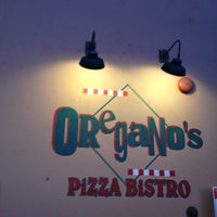 Photo taken at Oregano's Pizza Bistro by Rick B. on 12/2/2012