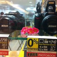 Photo taken at Fotokem by Mohd I. on 2/12/2013