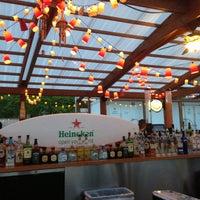 Photo taken at Oak Street Beach Food + Drink by Juan S. on 6/9/2013