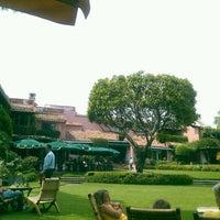 Photo taken at Las Mañanitas Hotel, Garden, Restaurant & Spa by Luis B. on 6/2/2013