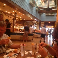Photo taken at Captain George's Seafood Restaurant by Erin S. on 7/12/2013