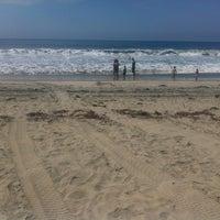 Foto tirada no(a) Breakers Beach por Michael F. em 7/14/2013
