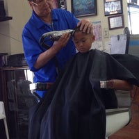 Photo taken at Phil-Am Barber Shop by Al Y. on 6/8/2014