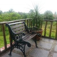 Photo taken at Kayu Manis Garden Resto & Gallery by Wiwien A. on 11/9/2013