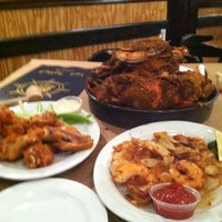 Photo taken at Crackpot Seafood Restaurant by K.C. W. on 10/19/2012