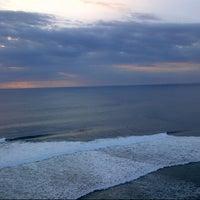 Photo taken at Suluban Beach by Ekha J. on 4/21/2013