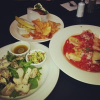 Photo taken at Osteria 166 by Christina L. on 6/21/2013