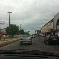 Photo taken at Avenida Arterial 18 by Jaqueline A. on 4/21/2013