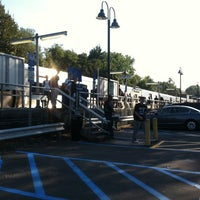 Photo taken at Metro North - Woodlawn Train Station by Chris S. on 10/5/2012