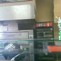 Photo taken at Slices n Ices by Stacy C. on 3/6/2014