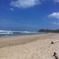 Photo taken at Playa Guiones by Patty J. on 7/5/2013