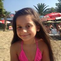 Photo taken at Palmiye Beach by Hatice M. on 8/9/2013