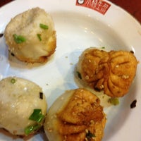 Photo taken at Yang's Fry Dumplings by Morgan B. on 7/23/2013
