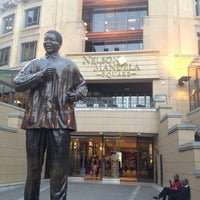Photo taken at Nelson Mandela Square by Claire K. on 6/7/2013