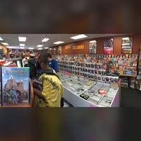 Photo taken at Titan Games & Comics by Malcolm T. on 5/2/2015