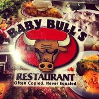 Photo taken at Baby Bull's Restaurant by David B. on 12/9/2013