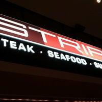 Photo taken at Strip by Kian B. on 10/8/2011