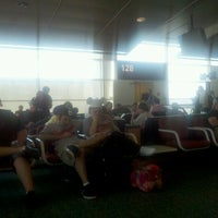 Photo taken at Gate 129 by Denise H. on 4/9/2012