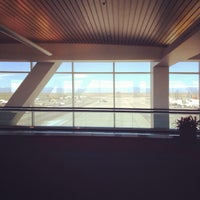 Photo taken at Gate A27 by Stephanie T. on 10/19/2013