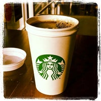 Photo taken at Starbucks by Johnny Y. on 1/18/2014