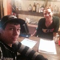 Photo taken at Zebra bar by Alex B. on 2/5/2015