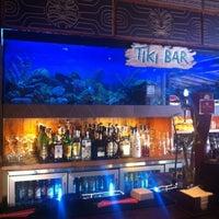 Photo taken at Tiki Restaurant Lounge Bar by Monica E. on 4/28/2013