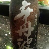 Photo taken at Sake Cafe by Moises D. on 2/1/2014