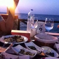 Photo taken at Calamari Restaurant by Mehmet G. on 7/7/2013