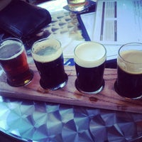 Photo taken at World of Beer by Dare O. on 7/14/2013