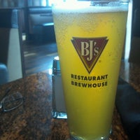 Photo taken at BJ's Restaurant and Brewhouse by Nadine B. on 4/27/2013